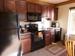 New sunny kitchen fully stocked for great cooking. Keurig and regular coffee makers.