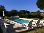 The 10 x 5 swimming pool in the large garden is shared with La Maison