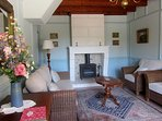 The beautiful and comfortable living room with woodburner for cooler evenings in spring and autumn
