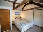 Double bedroom with vaulted ceiling and harbour views