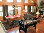 Game room with Pool Table, Foosball 12 ft shuffleboard, and card table.