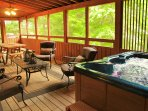 Hot tub in screened in porch.  Dining table and sitting area.  What's not to like.