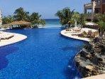 Infinity edge pool with swim-up bar and waterfalls (photo taken from pool bridge).