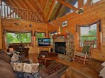 Lots of Room to Relax in the Open Area Living Room with Large Flat Screen TV and Cozy Fire Place