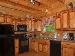 Enjoy the Fully Equipped Kitchen during your stay at Kozy Lodge