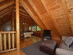 Enjoy a game of pool or a little R&R in the open-area loft room.