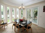 Bright dining room with easy access to the rear porch and yard