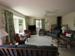 Relax with the whole family in the comfortable and well furnished living room.
