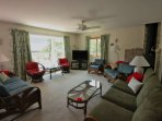 Comfortable and spacious living room for relaxing inside with the whole family.