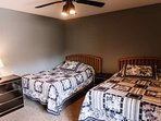 This large 2nd bedroom on the upper level has plenty of room for 2 full beds.