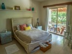 Spacious second room: queen size bed, wardrobe, bathroom, and balcony with cozy lounge