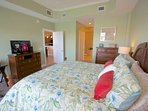 Unwind after a fun day at The Beach in this Spacious Master Bedroom with King Bed, Flat Screen TV, and Private Master...