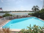 Spend a day in the Sun with the Family or Take a Dip after The Beach at This Convenient Community Waterfront  Pool