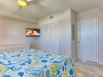 Unwind after a fun day at The Beach in this Spacious Master Bedroom with King Bed, Flat Screen TV