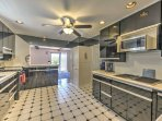 The stunning kitchen has stainless steel appliances and modern amenities.