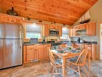 The kitchen features stainless steel appliances and gorgeous wood cabinetry.