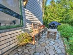 A stone patio lines the home's exterior.