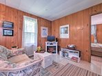 With a comfortable couch, wicker chairs, an electric fireplace and a flat-screen cable TV, the living area is a great...