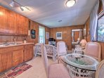 The kitchenette and dining room combine to form a great spot to gather with loved ones.