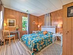 The master bedroom has a queen-sized bed and views of the beautiful outdoors!
