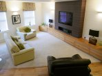 Beautifully furnished spacious living room with 50' TV.