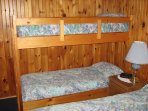 Bunk beds and a double bed in one bedroom in each cottage
