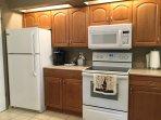 Pecan wood cabinets, new microwave/hood.