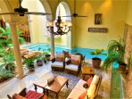 Stunning view of true indoor/outdoor living. Lounge area Pool Fountain Kitchen