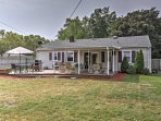 The charming home features a fenced-in backyard with furnished porch.