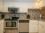 New Microwave, Tiled Floor, Ice Maker, Well Stocked Kitchen with lots of cabinets! Ice Maker!