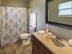 This en-suite master bathroom provides plenty of privacy  and comfort.