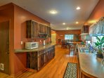 With 1,700 square feet of well-appointed living space, this home comfortably accommodates 8.