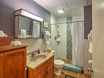 Recently renovated, the main level bathroom offers a tiled walk-in shower.