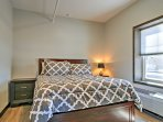 Retreat to the master bedroom for a cozy night on the queen-sized bed.