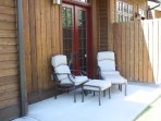 Porch seating out back with access to walking trails