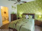 Master Suite 2 with comfortable Queen Bed & TV.  En-suite bathroom