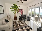Upstairs sitting room with 14 board games to keep you busy!  Views to the Caribbean sea facing north!