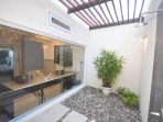 Outdoor shower for Bedroom #1 downstairs.  There is a choice of indoor shower and outdoor shower for this exquisite...