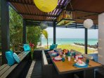 Breakfast outdoors at Dreamtime Villa with views to the ocean!