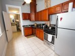 A modern kitchen with stainless steel appliances. It's fully stocked for all your needs.