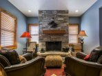 The private master suite features a king size bed (sleeps 2), a private living area with wood-burning fireplace...