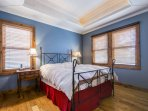 The master suite features a king size bed (sleeps 2), a private living area with wood-burning fireplace, walk-in closet...