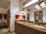 The master bathroom offers Guests a long marble counter top with his and hers vanity, custom hardwood cabinetry, glass...