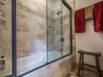 The master bathroom with jetted soaker bathtub.