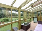 A warm, relaxing south facing conservatory. It heats the house with passive solar too !!