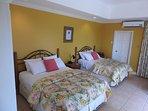 En-suite bedroom with door opening on to Caribbean Sea viewing private sun-terrace