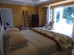 Master Bedroom with door opening on to Caribbean Sea viewing private sun-terrace