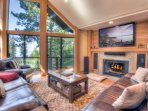 Living room with gas fireplace, flatscreen TV, and lake views