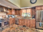 Gorgeous, large kitchen with stainless steel appliances and granite countertops