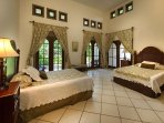 Guest Bedroom with Full Beds and French doors
